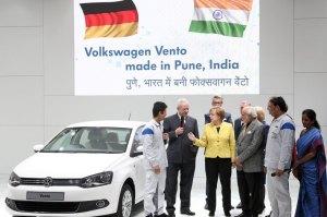 Martin Winterkorn samen met de indische premier Modi en kanselier Merkel op de industriebeurs van Hannover